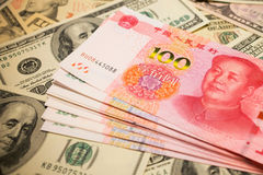 Chinese Yuan Note and U.S. dollar background Royalty Free Stock Images