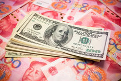 Chinese Yuan Note and U.S. dollar background Royalty Free Stock Photography