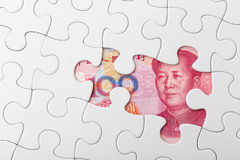 Chinese yuan and puzzle piece Royalty Free Stock Photo