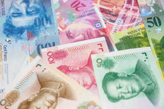 Chinese Yuan and Swiss Francs notes Stock Photos