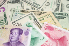 Chinese yuan and US dollar Stock Image