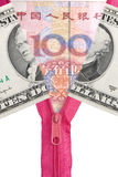 Chinese yuan and us dollars. Opened zipper with chinese yuan, concept of exchange war Stock Images