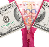 Chinese yuan and us dollars. Opened zipper with chinese yuan, concept of exchange war Stock Photography
