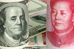 Chinese yuan and us dollars. Concept of exchange competition Royalty Free Stock Image