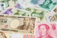 Chinese Yuans en Japanse Yen Stock Fotografie