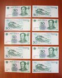 Chinese yuans by fifty (50) denomination are on a table one by one Royalty Free Stock Image