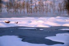 Chinese Yunnan lake, the morning snow. Stock Photos