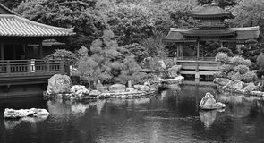 Chinese zen garden with pagoda and tea house Royalty Free Stock Images