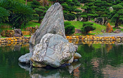 Chinese zen garden with rocks. Serene and beautiful chinese zen garden with wisdom rocks and spring foliage Stock Images