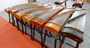 The chinese zither. The chinese guzheng, also named guqin or zither in the musical instrument store, xiamen city, china Royalty Free Stock Photo