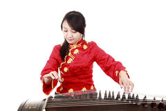 Chinese zither performer. In traditional dress playing zither on white.(close-up Stock Image