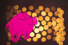 pink pig made of paper on black background with beautiful yellow bokeh in the background royalty free illustration