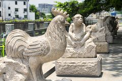 Chinese zodiac statues in shenzhen china. Chinese zodiac animal statues along a water canal in the longhua district of shenzhen china stock photography