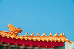 Chinese Zodiac on temple roof. With blue sky background royalty free stock images
