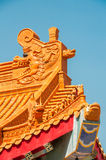 Chinese Zodiac on temple roof. With blue sky background royalty free stock image