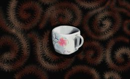 Chinesean cup of tee or coffee. Cup of tee or coffee, chocolate background, cup with chinesen art and fowers on it, background, cover for tee or caffee Royalty Free Stock Photos