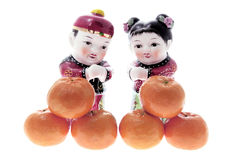 Chinesische Abbildungen und Mandarinen Stockbild