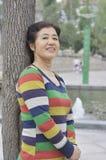 Chinesische Frau von mittlerem Alter Stockfotografie