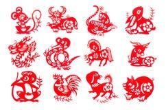Chinesische gesetzter roter Papierschnitt des Tierkreises 12 Stockbilder