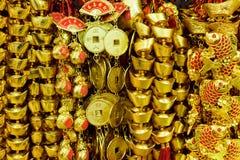 Chinesische goldene Münzen Stockbilder