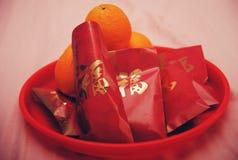 Chinesische Hochzeits-rote Umschlag-Orange Stockfoto