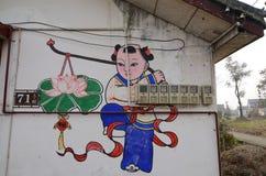 Chinesische Malerei des neuen Jahres in einer Wand. Stockbild