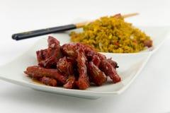 Chinesische Nahrung - knochenlose Ersatzrippen mit dem Schweinefleisch gebraten Stockbild