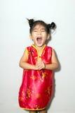 chinesische Reihe des asiatischen Mädchens im Rot lizenzfreies stockfoto