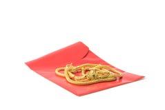 Chinesische rote Taschen und Halsspitzegold Stockfotos