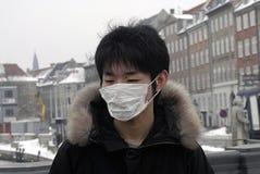 CHINESISCHE TOURISTEN MIT SCHABLONE Stockfoto