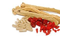 Chinesische traditionelle Medizin und westliche Medizin Stockbilder
