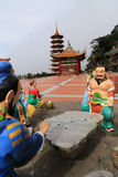 Chinesischer Gott, der Schachspielstatue spielt Lizenzfreies Stockbild