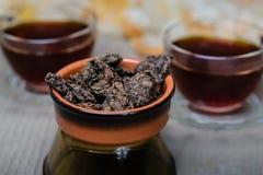 Chinesischer Tee - wild, comcopy Brüllen stockbilder