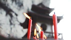 Chinesischer Tempel und Kerzenfeuer lizenzfreies stockfoto