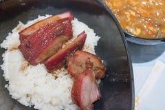 Chinesisches Grill-Schweinefleisch mit Reis Stockfotos