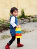 Chinesisches Kindspielen. Stockbild