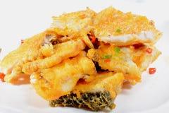 Chinesisches Lebensmittel: Gebratene Fischfilets Stockfotografie