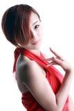 Chinesisches Mädchen, das ein rotes Kleid trägt Lizenzfreies Stockfoto