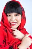 Chinesisches Mädchen im Rot Stockfotos