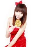 Chinesisches Mädchen mit süßer Süßigkeit Lizenzfreie Stockbilder