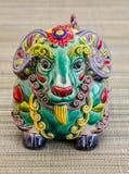 Chinesisches Spielzeug, das das Jahr 2015 auf dem Kalender das Jahr der Ziege darstellt Lizenzfreie Stockfotografie