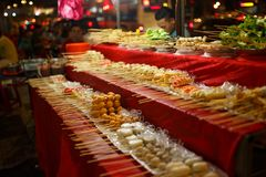 Chinesse street food on stick bar at night city streets royalty free stock photography