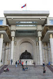 Chinggis Khan Statue. Visitors look at a statue of Chinggis Khan (Genghis) at the parliament building in downtown Ulanbaataar in Mongolia Stock Photo