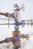 Chink. Oil well in a frosty winter icy cold Royalty Free Stock Photos