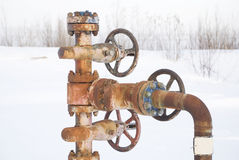 Chink. Oil well in a frosty winter icy cold Royalty Free Stock Photography