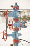 Chink. Oil well in a frosty winter icy cold Stock Photo