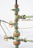 Chink. Oil well in a frosty winter icy cold Stock Image