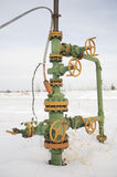 Chink. Oil well in a frosty winter icy cold Royalty Free Stock Images