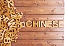 Chino de la palabra hecho con las letras de madera Fotografía de archivo