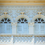 Chino-Portuguese style architecture in Phuket. Retro wooden windows and decoration of Chino Portuguese style architecture in Phuket, Thailand Royalty Free Stock Photography